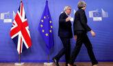 Theresa May y el presidente de la Comisión Europea, Jean-Claude...