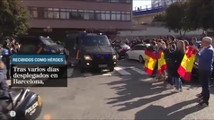 Regresan como héroes los policías gallegos desplegados en Barcelona