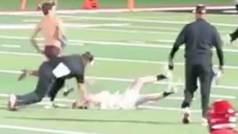 La humillación total a un espontáneo: Casi le arrancan la cabeza y lo sacan a rastras del campo